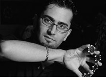 poker player Antonio Esfandiari is holding chips in his right hand - l.a. poker classic