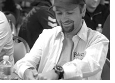 poker player daniel negreanu is hiding his cards while playing poker