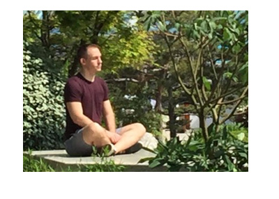 Social media photo: Justin Bonomo meditating at the Japanese Gardens in Monte Carlo.  Spring of 2018.